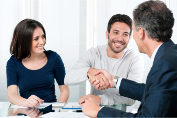 couple having a deal with a businessman